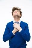 Man in glasses straightens his tie Stock Photos