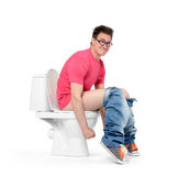 Man with glasses straining on the toilet Royalty Free Stock Photography