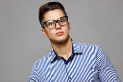 Man with glasses and a striped shirt Stock Photography