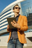 Man in glasses with the tablet stock images
