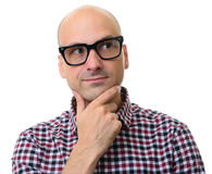 Man in glasses thinking and looking away. Bald man in glasses thinking and looking away. Isolated on white background Royalty Free Stock Photos