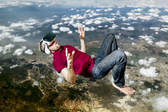 The man in glasses virtual reality flying on sky Stock Photos