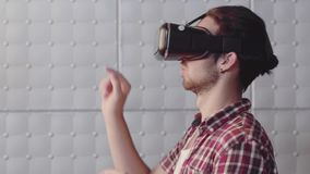 A person in virtual glasses. Man with glasses of virtual reality. Future technology concept. Modern imaging technology