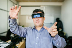 Man with glasses of virtual reality gesturing Royalty Free Stock Photography