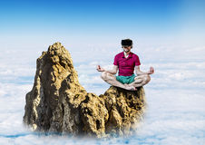 The man in glasses virtual reality sitting in the Lotus position Royalty Free Stock Photo
