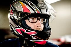 Man in glasses wearing crash helmet Stock Photography