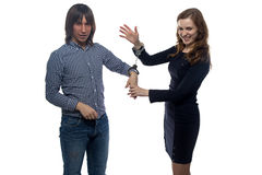 Man and gloating woman with handcuffs Stock Photos