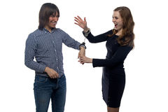 Man and gloating young woman with handcuffs. Man and gloating young women with handcuffs on white background Royalty Free Stock Photography