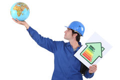 Man with a globe. And energy rating sign stock image