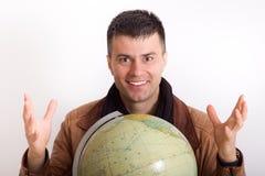 Man with globe Stock Photo