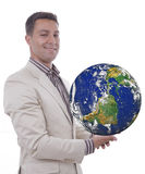 Man with globe in hands. A young man with a globe in his hands Royalty Free Stock Images