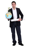 Man with globe and map Royalty Free Stock Photo