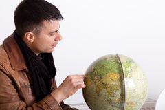 Man with globe Stock Images