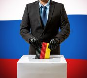 Man with glove throws German flag in voice box Stock Image