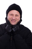 Man with gloves and a cap is smiling Royalty Free Stock Photos