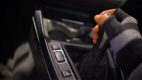 Man in gloves switching gearbox in expensive car, carjacking, offender. Stock footage stock footage