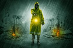Man with a glowing lantern at a catastrophe scene Stock Photography