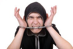 Man Gnaw a Handcuffs Royalty Free Stock Photography