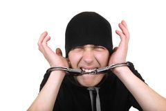 Man Gnaw his Handcuffs Stock Photography