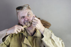 Man Gnawing A Bone Royalty Free Stock Photo