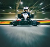 The man is in the go-kart on the karting track stock photos
