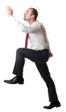 Man go up position Stock Images