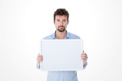 Man with goatee holding an empty board Stock Photos