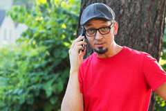 Man with goatee talking on cell phone Stock Photo