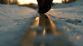 Man goes along the rail at sunset in winter stock video footage