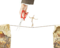 Man goes along a rope but another cuts it with a scissors Stock Photos