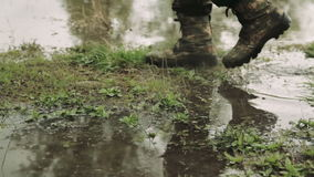 A man goes in army boots. A man in army boots. The hunter walks in khaki boots. The soldier overcomes obstacles stock video