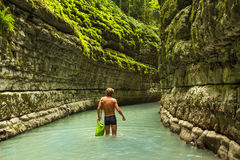 The man goes on deep canyon in the jungle Stock Photos