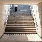 Man goes down on the stairs Royalty Free Stock Image