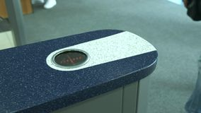 A man goes through an electronic turnstile to a business center or office building. People pass the electronic turnstile. With plastic card at the office stock video footage