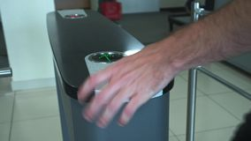 A man goes through an electronic turnstile to a business center or office building. People pass the electronic turnstile. With plastic card at the office stock footage