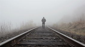Man goes in the fog stock footage