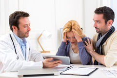 Man goes with his girlfriend on her visits to the doctor Royalty Free Stock Photo
