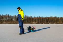 Man goes ice fishing Stock Photography