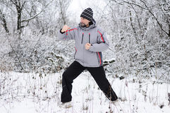 Man goes  for sports in winter outdoors Stock Photos