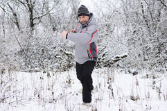 Man goes  for sports in winter outdoors Royalty Free Stock Photography