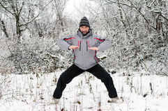 Man goes in for sports in winter outdoors Royalty Free Stock Photography