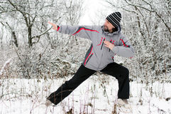 Man goes in for sports in winter outdoors Stock Image