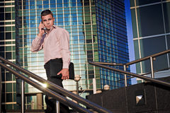 Man goes to office and speaks on the phone Royalty Free Stock Photo