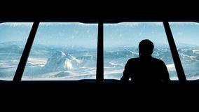 Man Looks Out From Arctic Base. Man goes to window in Arctic base building and looks out on frozen landscape in snowstorm stock footage