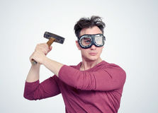 Man in goggles and old rusty hammer Stock Photo