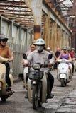 Man going across Long Bien steel bridge in Hanoi. On a moped Royalty Free Stock Images