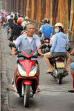 Man going across Long Bien steel bridge in Hanoi. During morning rush hour on a moped Royalty Free Stock Images