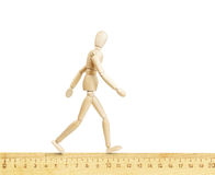 Man going along the mathematical ruler Royalty Free Stock Image