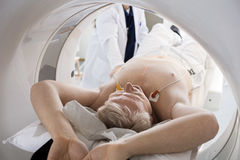 Man Going Through CT Scan In Hospital Stock Photo