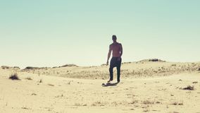 Man is going in desert. 1920x1080 stock footage